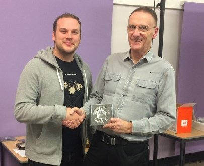 "Jack Reid receives a Robert Lane CD as third prize for ""Hello"""